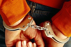 aressed person in handcuffs