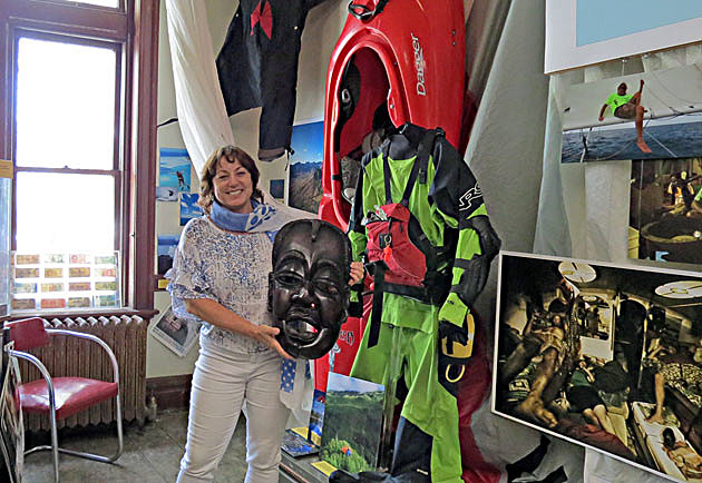 Standing in front of some of Tyler Bradt's sports equipment is museum director Tamar Stanley, with an African mask. (Steve Fullerton, Townsquare Media)